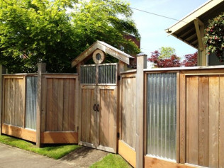 6' Cedar Fence with Corrugated Roofing Metal and Custom Arbor